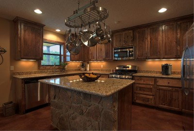 barndominium kitchen with wooden cabinets