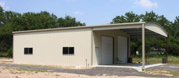 Texas metal building with lean/to roof on the side.